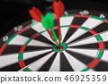 Three Darts hit red target close-up 46925359