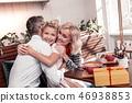 Joyful positive nice family hugging each other 46938853