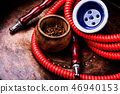 Smoking hookah with tobacco 46940153
