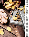 Fresh ginger on rustic background 46941588