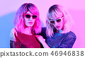 Two Glamour woman in fashion neon light. Party 46946838