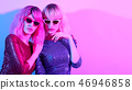 Two Glamour woman in fashion neon light. Party 46946858