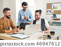 Group of young businessmen with laptop working in a modern office. 46947612