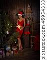 Girl and Christmas tree 46954333