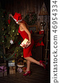 Girl and Christmas tree 46954334