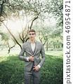 Handsome groom at wedding 46954871