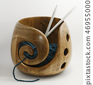 knitting needles and wool in a wooden bowl 46955000