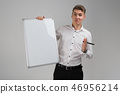 Portrait of young man with clean magnetic Board and marker in his hands isolated on white background 46956214
