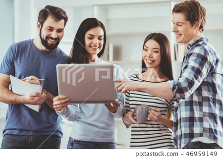 Cheerful nice woman holding a laptop 46959149