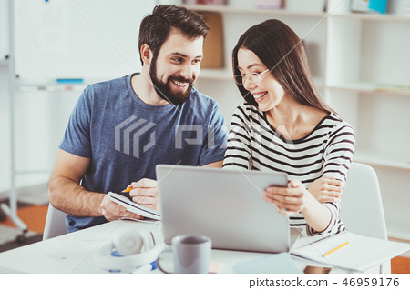 Nice young students sitting in front of the laptop 46959176