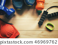 Fitness and sport equipment wooden background  46969762