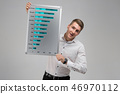 Portrait of young man with clean magnetic Board in his hands isolated on white background 46970112
