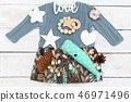 Babyl clothes and toys on a wooden background.  46971496