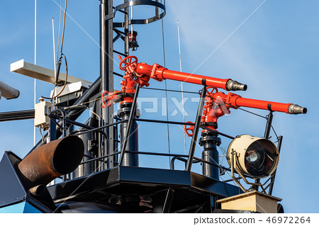 Water cannons aboard on a fire boat 46972264