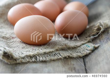 Fresh eggs on the wooden floor 46974560