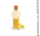 Glass bottle of fresh rapeseed oil and small yellow flowers. Natural product. Cooking ingredient 46976764