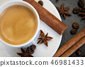 Coffee set. Espresso drink in white cup with cinnamon quills and star anise 46981433