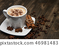 Cup of coffee on dark background. With cinnamon sticks, coffee beans and star anise 46981483