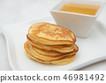 Pancakes and honey. In white porcelain plates 46981492