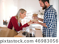 Young shop assistant serving an attractive woman in a zero waste shop. 46983056