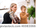 A young woman with a toddler boy buying groceries in zero waste shop. 46983066