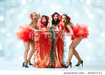 young beautiful dancers posing on studio background 46983312
