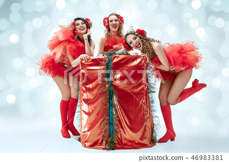young beautiful dancers posing on studio background 46983381