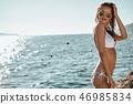 Bikini girl on the beach. Young beautiful woman in bikini on the 46985834