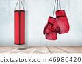 3d rendering of red punching bag and boxing gloves on grey wall and white wooden floor background 46986420