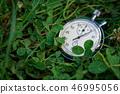 Stopwatch lies on green grass, sportive concept 46995056