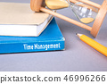 time management concept. blue book on a gray office table 46996266