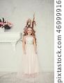 little girl wearing luxury dress 46999916