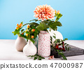 Vase with beautiful chrysanthemum flowers on light table 47000987