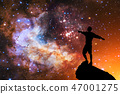 Beautiful night sky with stars and silhouette of a standing alone man 47001275