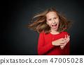 Excited surprised preteen girl screaming of joy 47005028