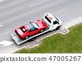 fast oldtimer car on the carrier vehicle 47005267