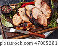 Roasted pork ham on a chopping board 47005281