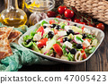 Greek salad with fresh vegetables 47005423