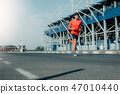 Athlete runner feet running on road 47010440