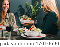 Young Woman In A Vegetarian Restaurant 47010690
