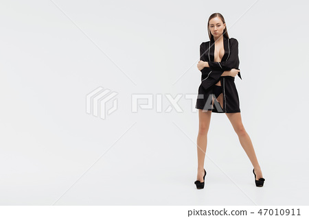 Beautiful sexy slim woman on white background 47010911