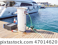 Shore Based Electricity Supply Appliance Power Supply And Battery Charged on the dock . 47014620