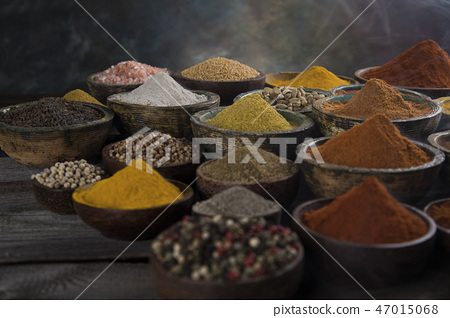 Assortment of spices in wooden bowl background 47015068