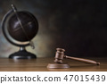 Globe, Law theme, mallet of judge, wooden gavel 47015439