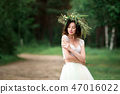 the bride in a beautiful white dress and a wreath of Forest flow 47016022