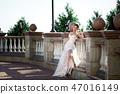 fashion photo of beautiful woman in wedding dress posing outdoor. 47016149