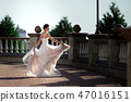 fashion photo of beautiful woman in wedding dress posing outdoor. 47016151