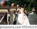 fashion photo of beautiful woman in wedding dress posing outdoor. 47016159