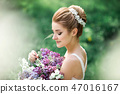 Portrait of young woman in the flowered garden in the spring time. 47016167