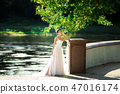 fashion photo of beautiful woman in wedding dress posing outdoor. 47016174